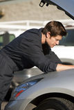Mechanic fixing car Stock Photography