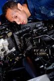 Mechanic fixing a car Royalty Free Stock Photos