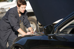 Mechanic fixing car Stock Photo
