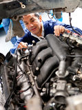 Mechanic fixing a car Stock Photos
