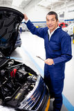 Mechanic fixing a car Stock Image