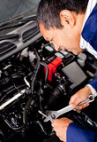Mechanic fixing a car Stock Photo