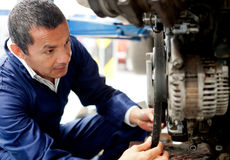 Mechanic fixing car Royalty Free Stock Photos
