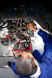 Mechanic fixing a car Royalty Free Stock Images
