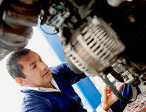 Mechanic fixing car Stock Images