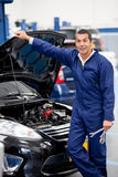 Mechanic fixing car Royalty Free Stock Image