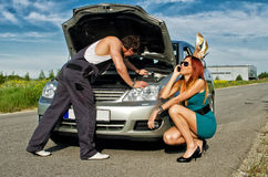Mechanic fixing a car. On a road stock image