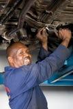 Mechanic fixing car Royalty Free Stock Photo