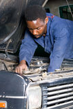 Mechanic fixing car Stock Photos