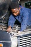 Mechanic fixing car Stock Photos
