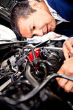 Mechanic fixing car engine Royalty Free Stock Image