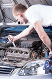 Mechanic fixing car engine Royalty Free Stock Images