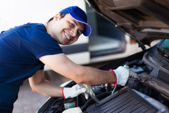 Mechanic fixing a car engine Stock Photography