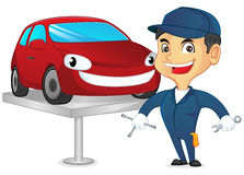 Mechanic fixing car and holding tools Royalty Free Stock Images