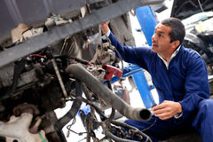 Mechanic fixing car problem Stock Photo