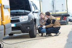 Mechanic fixing car problem on road royalty free stock photo