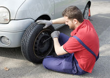 Mechanic fixing a car problem stock image