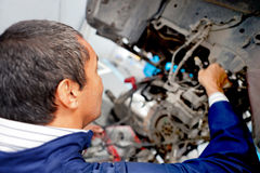 Mechanic fixing an engine Stock Image