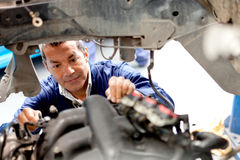 Mechanic fixing an engine Stock Photo