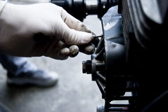 Mechanic fixing an engine. The Repair of the engine on stations of the technical maintenance. The Diagnostics and stripping royalty free stock photos