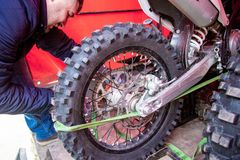 Mechanic fixing motorcycle wheel. Mechanic fixing motocycle worn motorcycle drum breaks shoes royalty free stock images