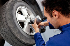 Mechanic fixing a puncture Stock Image