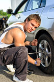 Mechanic fixing a tire Royalty Free Stock Images