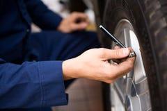 Mechanic: Focus on Tire Pressure Gauge Stock Images
