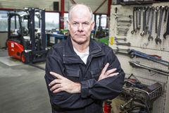 Mechanic in forklift garage royalty free stock images