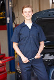 Mechanic in front of car at work Stock Photos