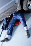 Mechanic in a garage Royalty Free Stock Photo