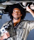 Mechanic in a garage Stock Image