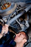 Mechanic in a garage Stock Photos