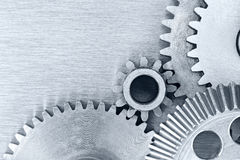 Mechanic gear cogwheels on industrial metal background Stock Images