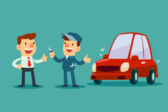 Mechanic give a key of repaired car back to his customer Royalty Free Stock Images