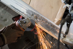 Mechanic grinding car body by grinder. Auto body repair stock photography