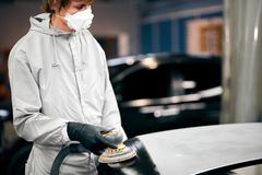 Mechanic grinds car part for painting. Car body work auto repair paint after accident. Auto mechanic grinds car part for painting. Car body work auto repair stock photo