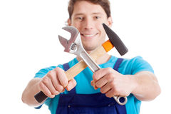 Mechanic with hammer and wrench Royalty Free Stock Photo
