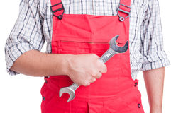 Mechanic hand holding big wrench Royalty Free Stock Photography