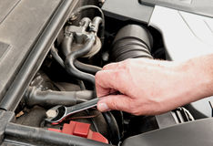 Mechanic hand working on car engine stock images