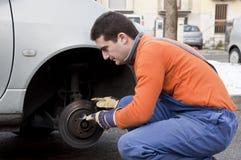 Mechanic hand on worn brake Royalty Free Stock Images