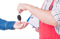 Mechanic handing car key to customer or client hand Stock Images