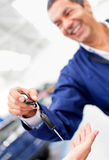 Mechanic handling car keys Royalty Free Stock Photos