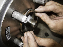 Mechanic hands fixing car. Brakes and rotors rubber gasket Stock Photo