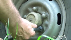 Mechanic Hands Replace Car Tire Outdoor. Closeup. stock video footage