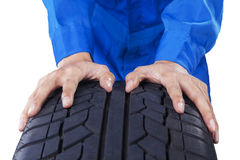 Mechanic hands with textured tire Royalty Free Stock Photography