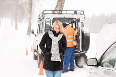 Mechanic helping woman with broken car snow Royalty Free Stock Photography