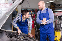 Mechanic helps insurance agent Stock Images