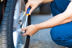 Mechanic in his workshop changing tires or rims stock image