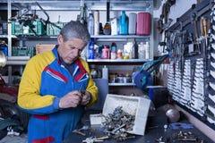 Mechanic at his workshop Stock Photos